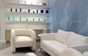 A waiting area and a display shelf with skincare products offered for sale at Kalos Hair Transplant, LLC in Atlanta GA.