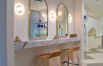 Mirrors in the Kalos Hair Transplant, LLC hallway