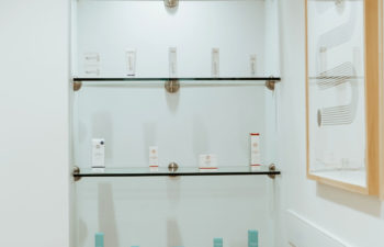 A display shelf with skincare products offered for sale at Kalos Hair Transplant, LLC in Atlanta GA.